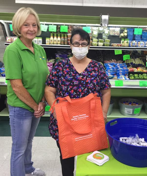 Two ladies in Floyd's Grocery, winners of Shop Smart.